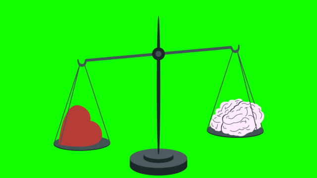 Heart-Vs-Brain-on-Scales-on-a-Green-Screen