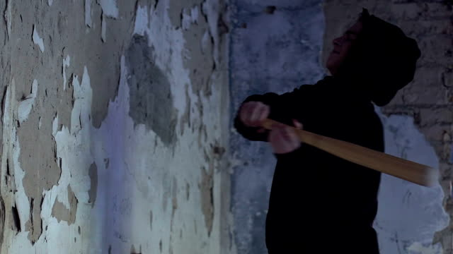 Angry-teenager-hitting-wall-with-baseball-bat-feels-desperate-hopelessness