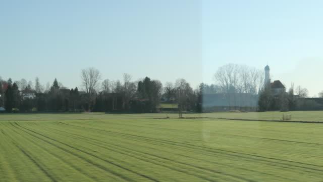 Landscape-passing-seen-through-train-window