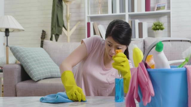 asian-woman-doing-housework-hard-in-daytime