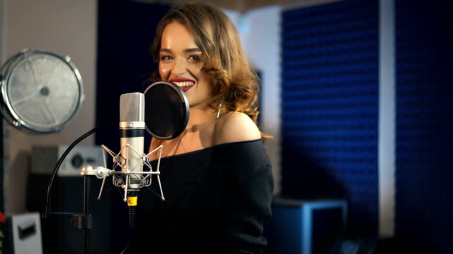 Beautiful-woman-singing-into-a-large-microphone-