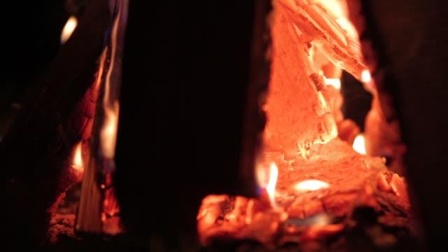 fire-burning-at-night-closeup-campfire-on-dark-autumn-night-warmth