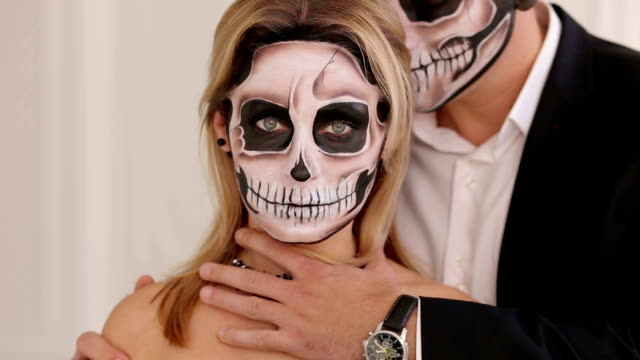 Creepy-couple-with-scary-Halloween-makeup-in-vintage-costumes-in-a-studio-