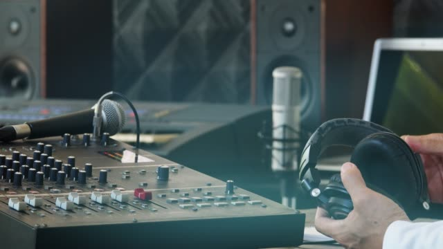 Music-producer-working-in-recording-studio-