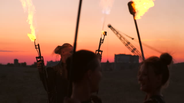 A-man-with-a-flamethrower-at-sunset-in-slow-motion-Costume-for-zombie-Apocalypse-and-Halloween-