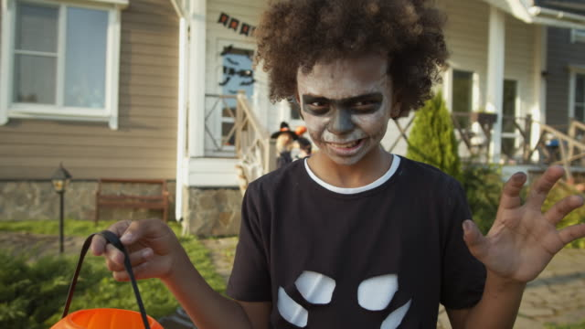 African-Teenager-Trick-or-Treating