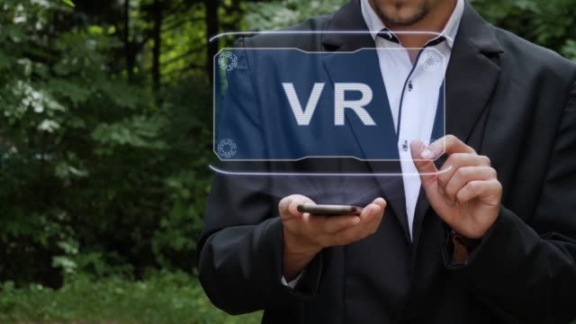 Businessman-uses-hologram-with-text-VR