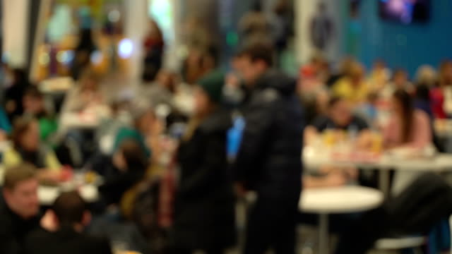 Concept-junk-food-Unrecognizable-people-eating-fast-food-in-mall-food-court