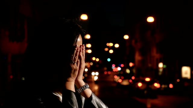 Desperate-Chinese-woman-alone-in-street-at-night-begins-to-cry--slow-motion