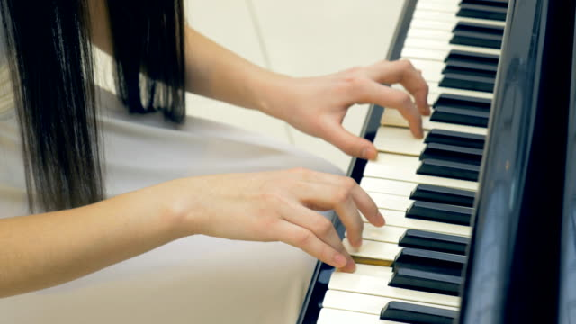 The-close-up-of-the-pianist-s-hands-playing-the-piano-Steadicam-4K-