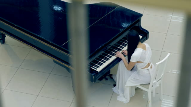 Shooting-from-the-above-of-the-girl-playing-the-piano-No-face-4K-