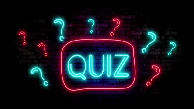 Quiz-Neon-Light-on-Brick-Wall