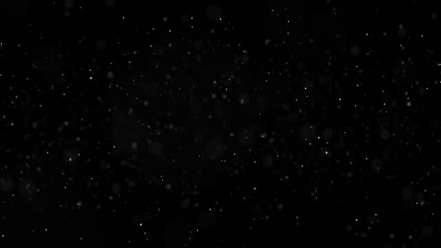Movimiento-de-partículas-blancas-abstractas-sobre-fondo-negro