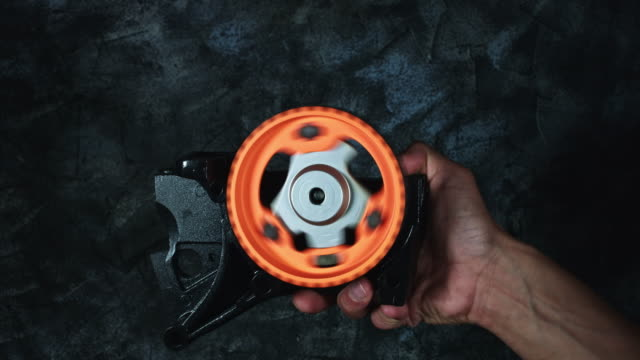 4k-Technical-Composition-of-Mechanic-Hands-Holding-Spinning-Gear