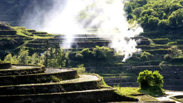 Rice-terraces-burning-for-farm-manur-4K-Time-Lapse