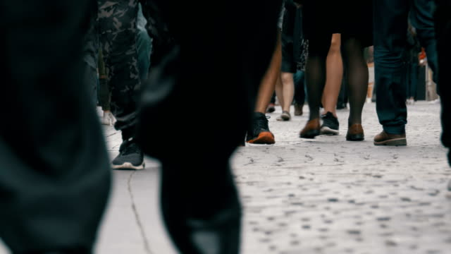 Feet-of-Crowd-People-Walking-on-the-Street