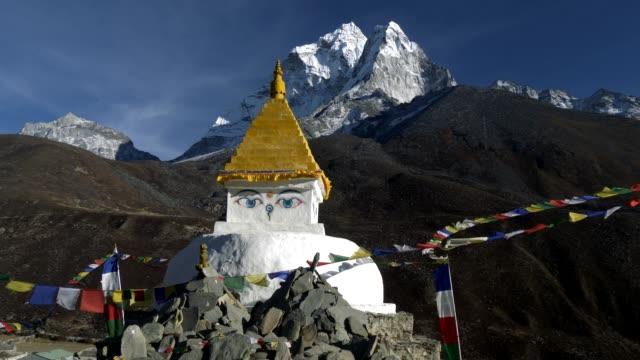 Buddhist-stupa-on-mountain-trekking-path-in-Himalayas-Nepal-Crane-shot-4K-UHD