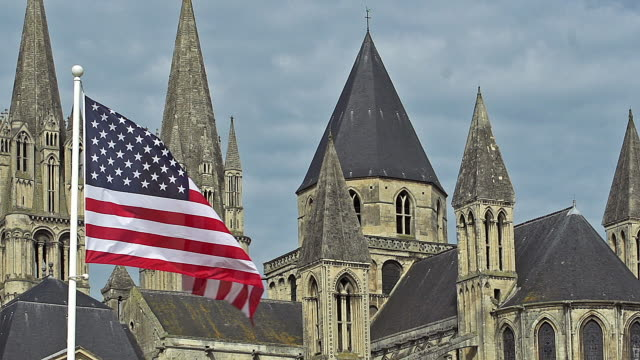 American-Flag-Waving-in-the-Wind-Caen-City-in-Normandy-Slow-Motion