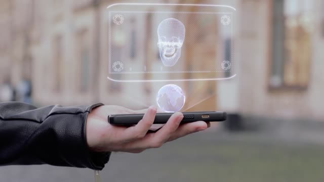 Male-hands-show-on-smartphone-conceptual-HUD-hologram-human-skull
