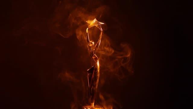 gold-woman-statue-smoke-dark-background-hd-footage