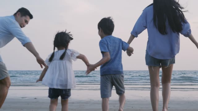 SLOW-MOTION-Asian-family-running-with-happy-emotion-at-Beach-together-Family-Holiday-and-Travel-concept-