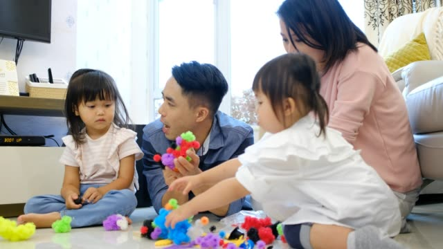 Asian-family-playing-toy-blocks-at-home