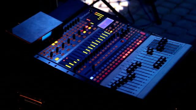 Audio-mixer-working-on-rock-concert