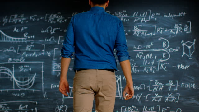 Brilliant-Young-Mathematician-Approaches-Blackboard-and-Finishes-Solving-Long-and-Complex-Equation-