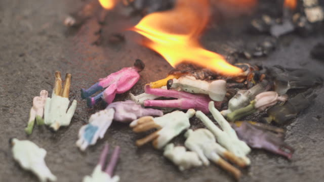 Burning-people-Models-of-people-are-burning-The-concept-of-aggression-ecology-danger-4k