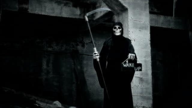death-with-a-scythe-raises-a-sign-with-the-inscription-wake-up