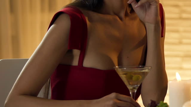 Asian-woman-ignores-boring-man-on-date-embarrassing-conversation-close-up