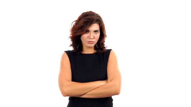 Displeased-upset-young-woman-crossing-her-arms-and-looking-in-the-camera-isolated-on-white-background