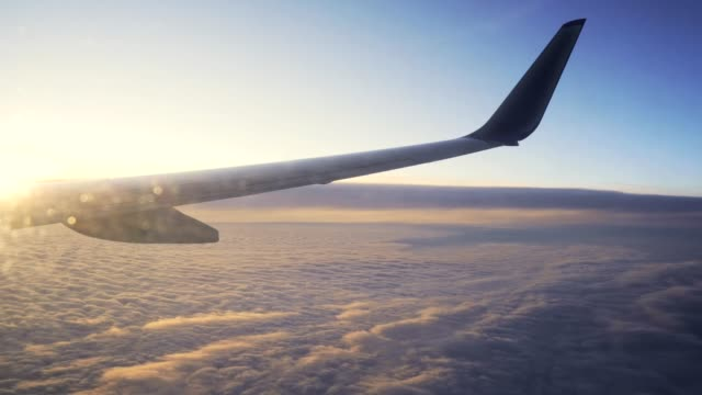 Sunset-in-the-sky-from-the-airplane-window-wing-of-the-plane-