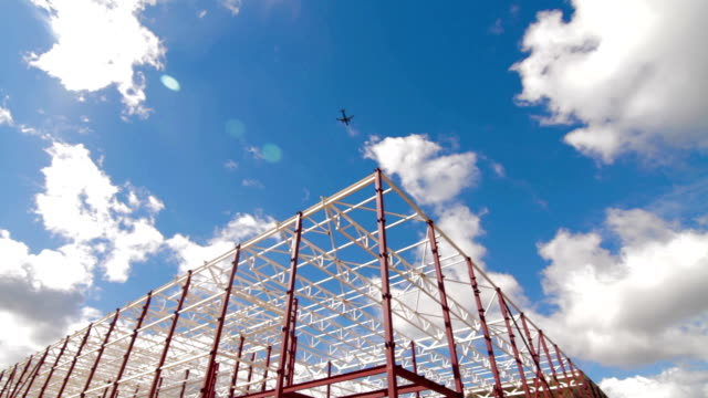Building-new-large-warehouse-complex-Airplane-inb-lue-sky