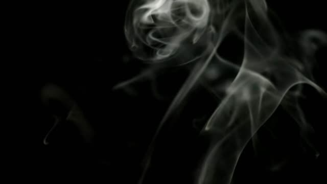 white-smoke-with-bright-scraps-on-black-isolated-background-Great-for-overlay-in-a-video-editor