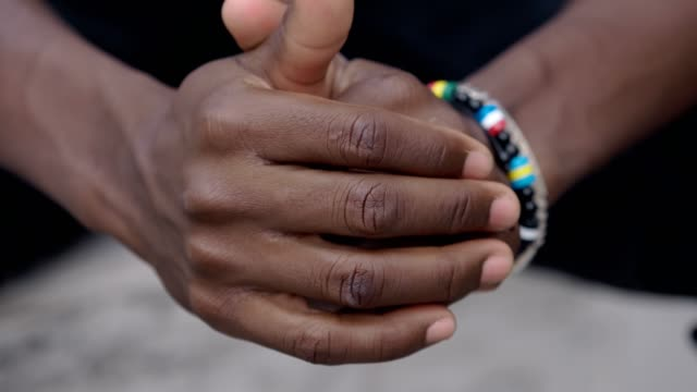 focus-on-Problems-worries-thoughts-Young-black-man-alone-rubbing-his-hands-thinking