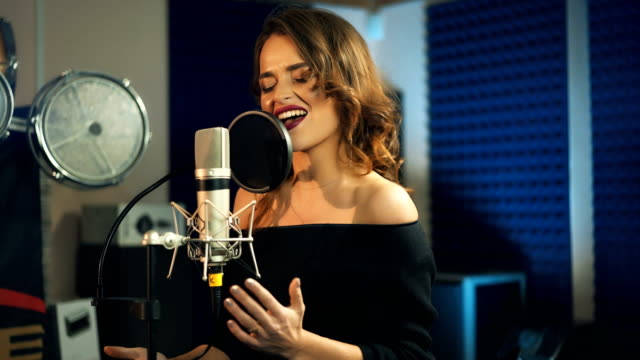 Beautiful-young-singer-who-recorded-a-song-in-a-professional-recording-studio-