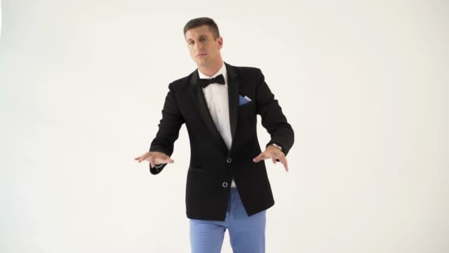a-man-in-a-black-jacket-is-depicting-play-the-piano-on-a-white-background-in-the-studio-