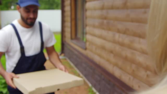 Man-Delivering-Pizza-to-Unrecognizable-Woman