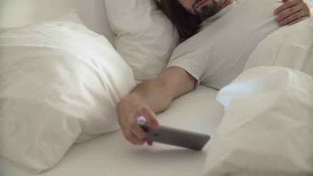 Wake-Up-Man-Sleeping-In-Bed-With-Phone-Alarm