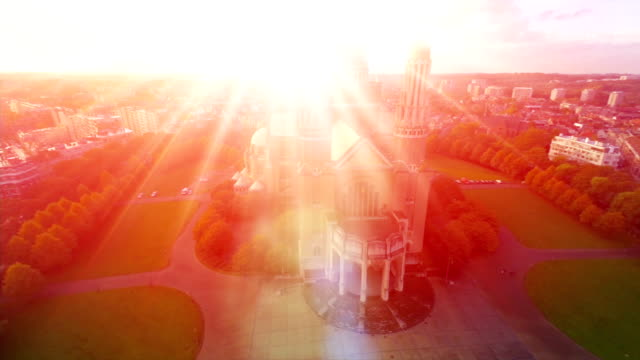 Religion-symbol-bright-light-from-church-Love-and-God-symbol-aerial-fly-over-worship-and-sacrifice-Bright-light-resembles-hope-and-religious-blessing-catholic-temple-building-means-faith