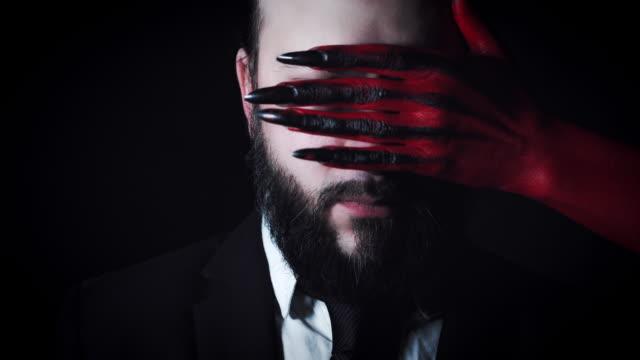 4k-Horror-Devil-s-Hand-Covering-Businessman-Eyes