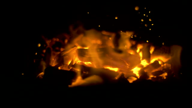 Flying-glowing-bonfire-embers-into-the-dark
