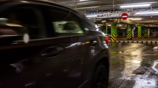 motion-of-cars-at-entrance-and-exit-in-underground-shopping-mall-parking-time-lapse
