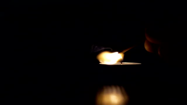 Lighting-a-match-stick-from-candle-slow-motion