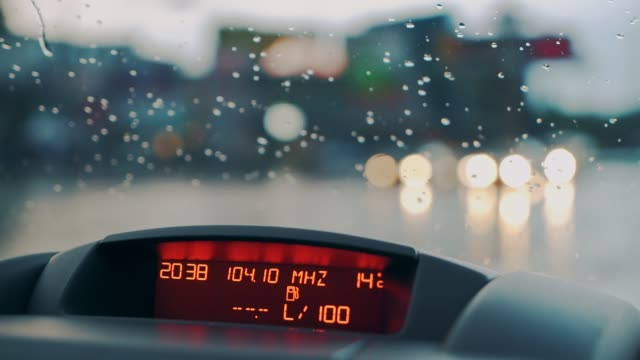 Raindrops-fall-on-the-windshield-of-the-car-