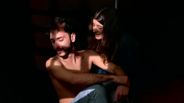 Sad-Man-crying-in-the-dark-his-girfriend-comforting-Depression-suicide