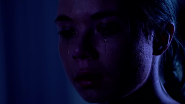 Unhappy-young-woman-crying-psychological-trauma-domestic-violence-closeup