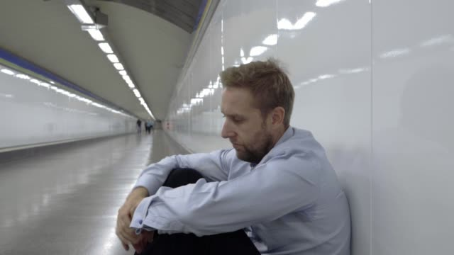 Desperate-sad-young-businessman-suffering-emotional-pain-grief-and-deep-depression-sitting-alone-in-tunnel-subway-in-Stress-life-style-Work-problems-failure-Unemployment-Mental-health-and-Depression-