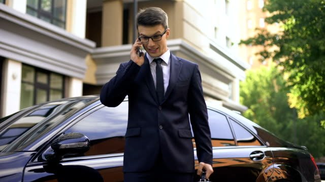 Anxious-young-man-talking-on-phone-with-contractor-bad-fulfillment-of-contract